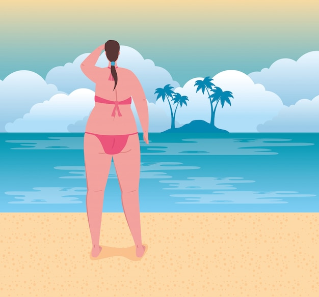 Cute plump woman in swimsuit pink color on the beach, summer vacation season