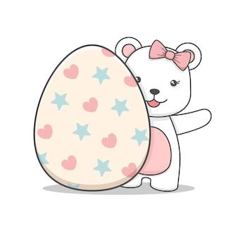 Cute polar bear girl behind an easter egg isolated on white
