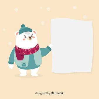 Cute polar bear holding blank sign