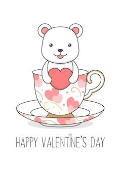 ハートのバレンタインデーを保持しているカップのかわいいホッキョクグマ