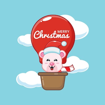 Милый белый медведь в рождественский день летает на воздушном шаре