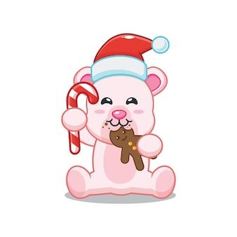 Милый белый медведь в шапке санта-клауса и ест рождественское печенье милая рождественская карикатура