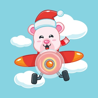 Cute polar bear wearing santa hat fly with plane in christmas day