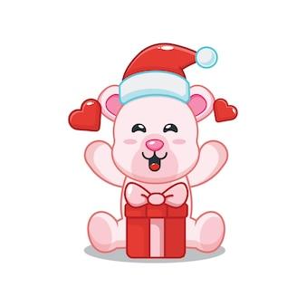 Милый полярный медведь в новогодней шапке с подарочной коробкой