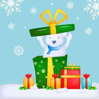 クリスマスプレゼント付きのかわいいホッキョクグマ。メリークリスマス。
