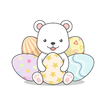 Cute polar bear with easter eggs isolated on white