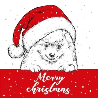 Милый щенок в шляпе санта-клауса. новый год и рождество.
