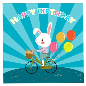 お誕生日おめでとうカードのためのかわいいウサギのサイクリング