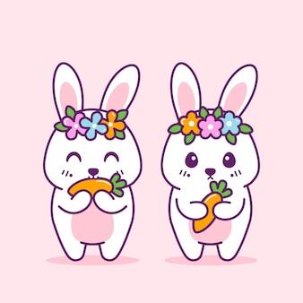 かわいいウサギはピンクで隔離の花とニンジンをもたらします