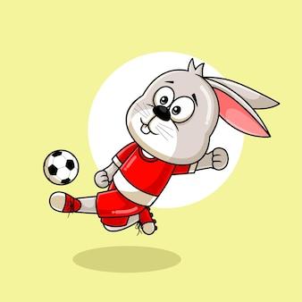 Мультфильм милый кролик пинает мяч иллюстрации Premium векторы