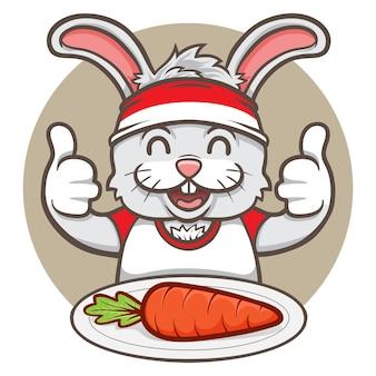 おいしいニンジンを食べるかわいいウサギ