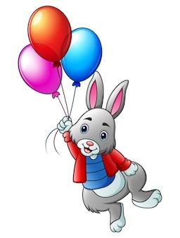 Симпатичный кролик, полет с воздушными шарами на белом фоне