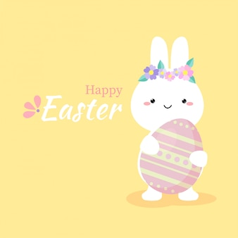 Cute rabbit holding colorful easter egg.