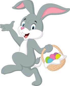 Cute rabbit holding easter basket