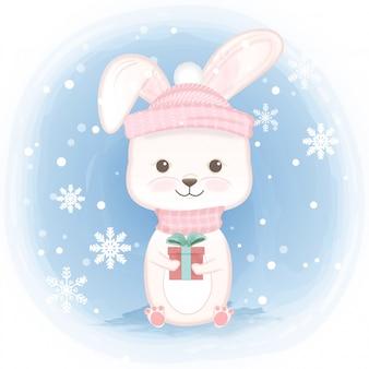 Cute rabbit holding gift box