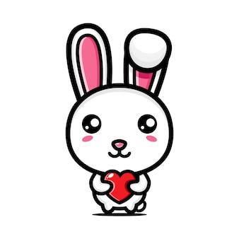 Милый кролик обнимает сердце любви