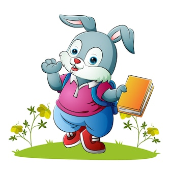 The cute rabbit is holding the colorful book of illustration
