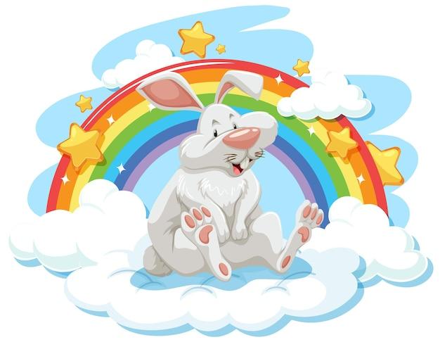 무지개와 함께 구름에 귀여운 토끼