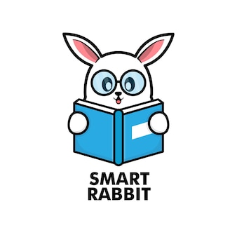 Cute rabbit reading book cartoon icon logo illustration Premium Vector