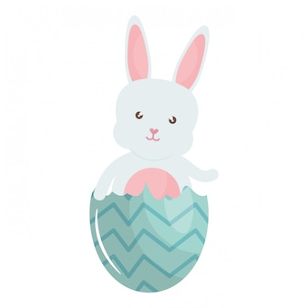 Cute rabbit with broken easter egg painted