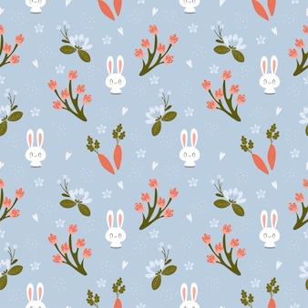ニンジンと様々な花のシームレスなパターンとかわいいウサギ