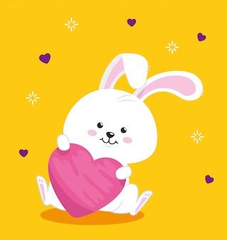 노란색 배경에서 마음으로 귀여운 토끼