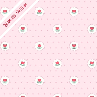 Cute red flowers and dots on a pink background seamless pattern