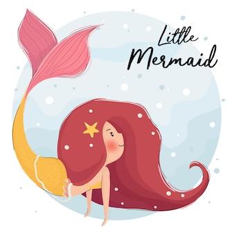 바다에서 귀여운 빨간 머리 인어