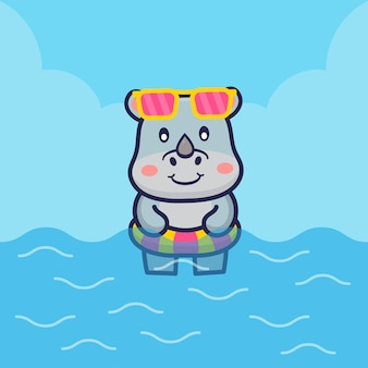 Милый носорог плавает с иллюстрацией кольца для плавания