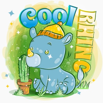 귀여운 코뿔소는 모자와 앉아 잔디 그림을 착용