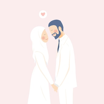 Cute romantic muslim wedding couple holding hands contented and happy in their wedding moment