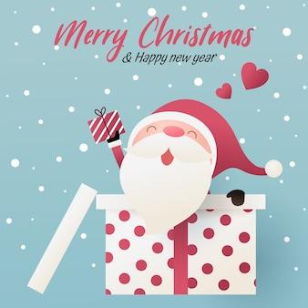 Милый санта-клаус смотрит на подарок из большой подарочной коробки. с новым годом и рождеством иллюстрации