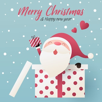 Cute santa claus hold a gift peek from inside a big gift box.  happy new year and merry christmas illustration