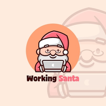 Cute santa smiling while working on his laptop