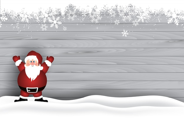 Cute santa in the snow on a wooden texture background