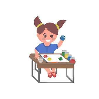 Cute school girl character sitting at the desk and painting isolated vector illustration