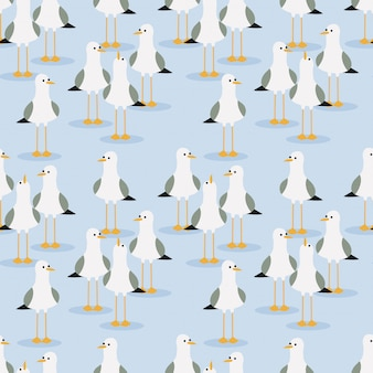 Cute seagulls seamless pattern on light blue background.