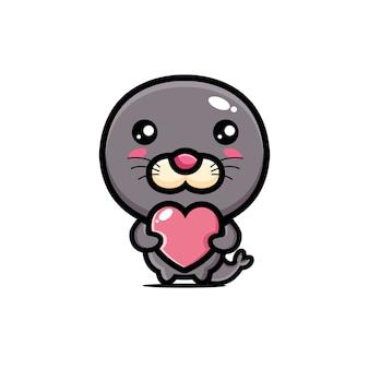 愛の心を抱き締めるかわいいアザラシ
