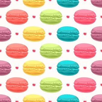 Симпатичный бесшовный фон с многоцветным вкусным миндальным печеньем и маленькими сердечками