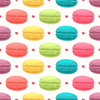 Cute seamless background with multi color delicious macaroon and small hearts