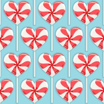 赤と白の縞模様のキャンディハートとかわいいのシームレスな背景