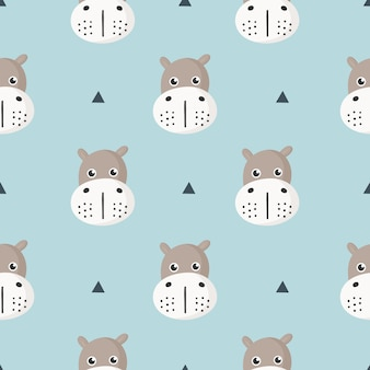 Cute seamless pattern with cartoon baby hippo for kids. animal on blue background.