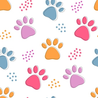 Cute seamless pattern with colorful pets paws. cat or dog footprint outline bright background with dots.