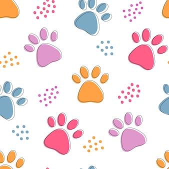 カラフルなペットの足でかわいいシームレスパターン。猫や犬の足跡は、ドットで明るい背景の輪郭を描きます。
