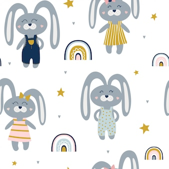 Cute seamless pattern with hares and rainbows.