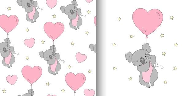 愛のコアラとかわいいシームレスパターン