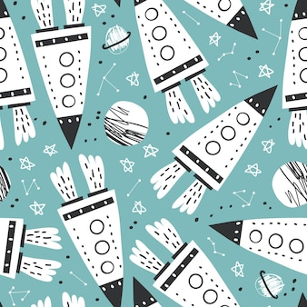 Cute seamless pattern with rocket, planets and stars