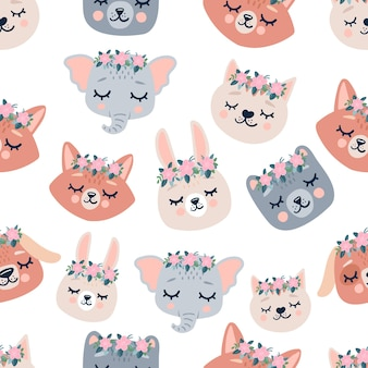 Cute seamless pattern with sleeping animals heads, flowers. hand drawn background with characters for children, fabric, stationery, clothes and pajamas in the scandinavian style.