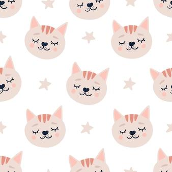 眠っている猫の頭と星とかわいいシームレスパターン。
