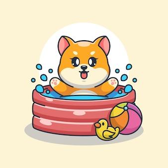 膨脹可能なプールで遊ぶかわいい柴犬